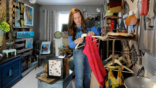 Roberta Steele, owner of R. Steele Finch, sets her shop up in Sioux Falls, SD; Wednesday, Aug. 26, 2015. The new pop-up shop opens Thursday, Aug 27 featuring items from 10 local artisans.