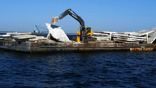 Concrete rubble that was once a seawall is being dumped on the two artificial reefs outside Manasquan Inlet to create more fish habitat.