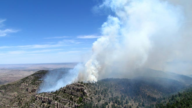 Smoke rises along Bush Mountain as the fire progressed to the south and east on May 11.