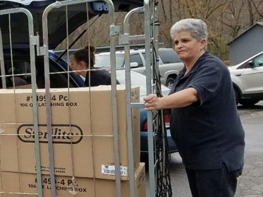 Woman helps load toys into a truck for Houston County