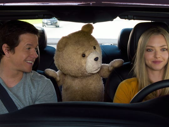 """Mark Wahlberg , from left, the character Ted, voiced by Seth MacFarlane, and Amanda Seyfried appear in a scene from """"Ted 2."""""""