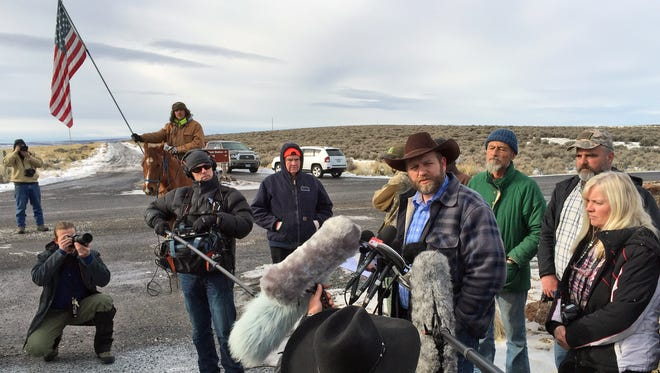 Ammon Bundy speaks to reporters at the Malheur National Wildlife Refuge in Burns, Ore., on Thursday, Jan. 14, 2016. Bundy is the leader of a small, armed group that has been occupying the remote refuge in Oregon since Jan. 2 to protest federal land policies.