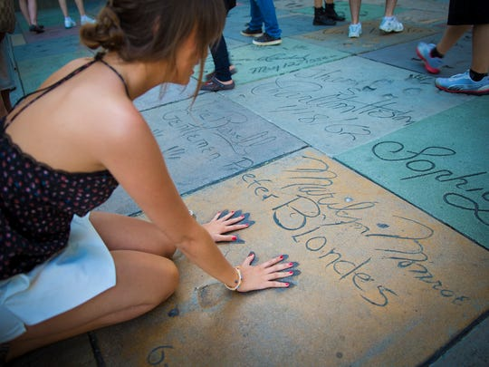 Be sure to match your handprints with Hollywood's famous impressions in front of the TLC Chinese Theatre.