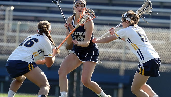 Pittsford's Megan Plain, center, shown in a game last month, had three goals and an assist in Saturday's regional lacrosse win. She was sidelined for 11 months with a leg injury.