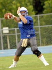Lebanon senior quarterback Jackson Gray throws a pass during a preseason scrimmage.