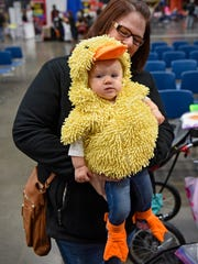 Emma Doyle, dressed as a baby duck, is held by her mother, Jennifer Doyle, during the Kids & Parents Expo Saturday, Oct. 29, at the River's Edge Convention Center in St. Cloud.