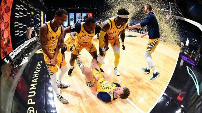 The Golden Eagles surround Travis Diener after he hit a 3-pointer to win the The Basketball Tournament on Tuesday.