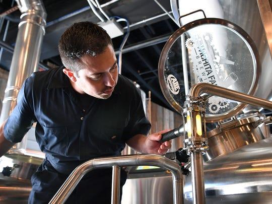 Brew master Matt Bitsche shines light through the sight