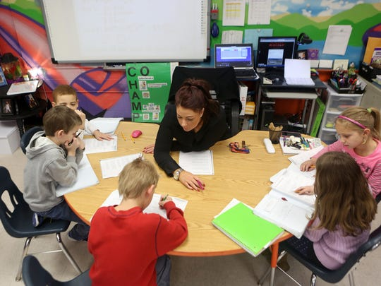 Education should be controlled at the state and local levels, not by a federal Department of Education, U.S. Rep. Thomas Massie says. Shown, Tara Macke, a third-grade teacher at Glenn O. Swing Elementary in Covington, works with students on math problems.