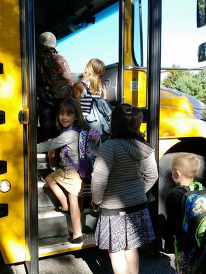 Reegan Kedrowski gets on the school bus for her first day of kindergarten at McDill Elementary School in Whiting. Her parents are Casey and Lindsey Kedrowski.