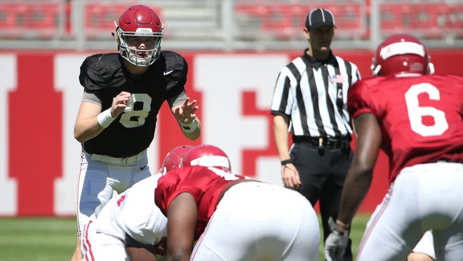 Quarterback Blake Barnett (8) gets ready to take a snap in Saturday's scrimmage.