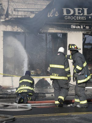 Mount Vernon firefighters fight a storefront fire on Gramatan Avenue on Oct. 19.