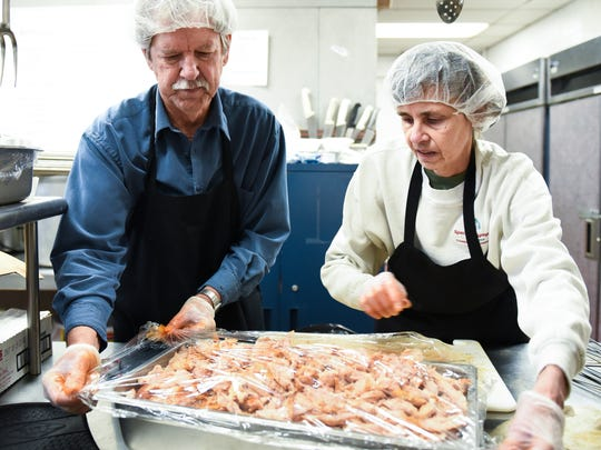 John and Margo Whalen of Charlotte prepare turkey in
