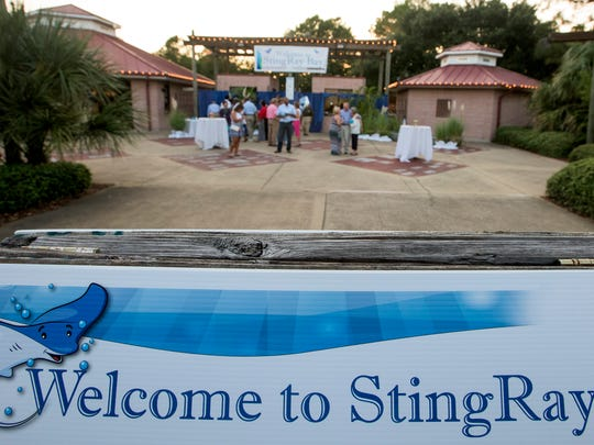 Locals take part in the food and spirits at the 'Zoobilation: Welcome to Stingray Bay' fundraiser at the Montgomery Zoo in Montgomery, Ala. on Thursday September 15, 2016.