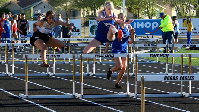 Carlsbad's Brooklyn Barta (center) and Jordan Boatwright compete in the girls 100-meter hurdles at the Gene Wells Relays on Thursday, March 24, 2016 at Hobbs. Carlsbad starts the 2017 season with a scrimmage on March 3 in Roswell.