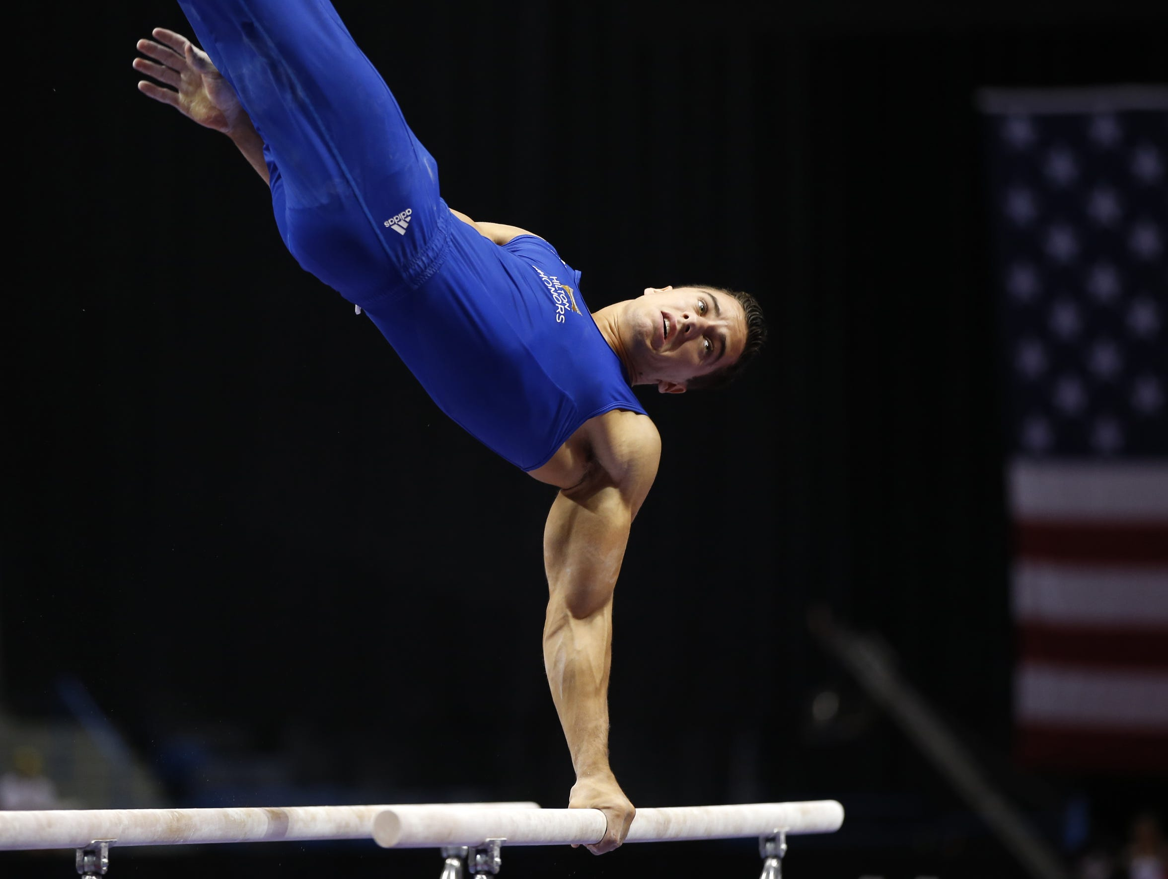Jake Dalton competes on the parallel bars during the