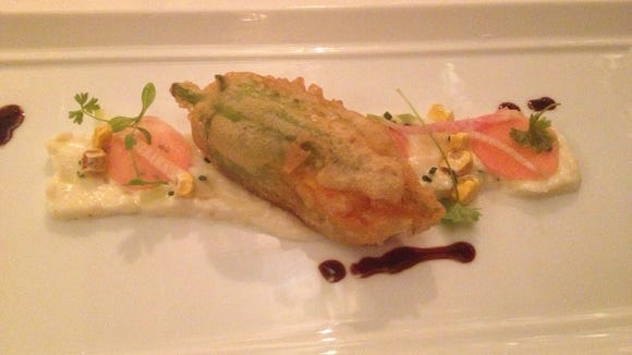 A stuffed squash blossom from the vegetarian tasting menu at Orchids.