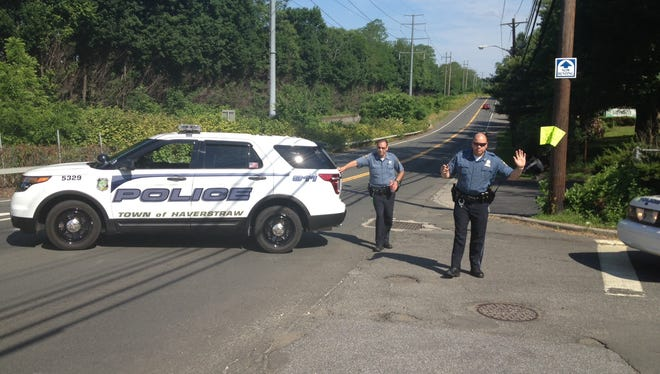 Haverstraw police direct traffic at Fairmount Avenue at Route 9W after a motorcyclist, John Cardarelli, 44, of New City, was killed Sunday, June 8, 2014, in a collision with a family's van.