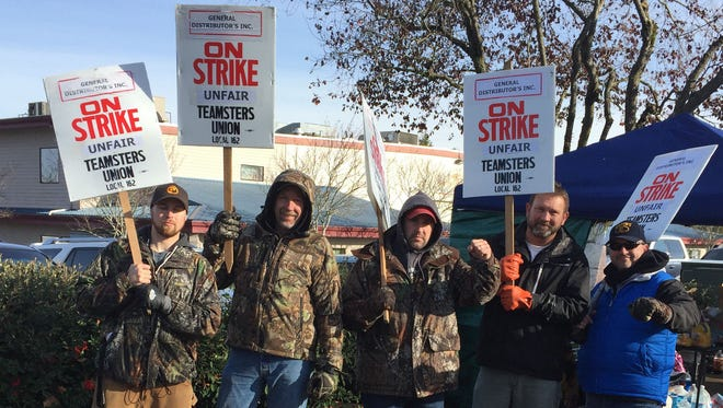Beer and wine deliveries slowed by strike at Portland-area beverage distributor.