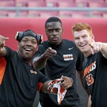 (Left to right) Bengals running back Jeremy Hill, wide receiver A.J. Green and quarterback Andy Dalton joke around during warm-ups before kickoff of the NFL preseason game between the Cincinnati Bengals and the Tampa Bay Buccaneers at Raymond James Stadium in Tampa, Fla., on Monday, Aug. 24, 2015.