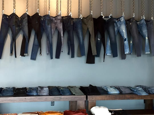 """The """"Denim Wall"""" at new Carmel boutique, Beauty and Grace, 751 Hanover Place."""