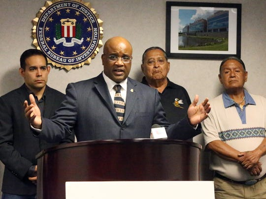 Emmerson Buie Jr., center, special agent in charge of the FBI El Paso field office, is joined by tribal leaders at an Oct. 13, 2017, news conference about the vandalism of a sculpture at the Ysleta del Sur Pueblo on Columbus Day 2017.