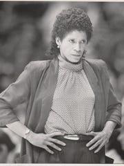 University of Iowa women's basketball coach C. Vivian Stringer sizes up situation during game with Minnesota.   Register staff photo, taken Jan. 11, 1985. Published in the Register Nov. 15, 1990.