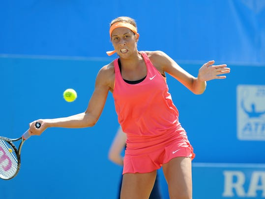 Madison Keys of the U.S. prepares to return to Britain's Heather Watson in their semifinal match at the Aegon International tennis tournament at Devonshire Park, Eastbourne, southern England, Friday June 20, 2014. (AP Photo/PA, Clive Gee) UNITED KINGDOM OUT  NO SALES  NO ARCHIVE