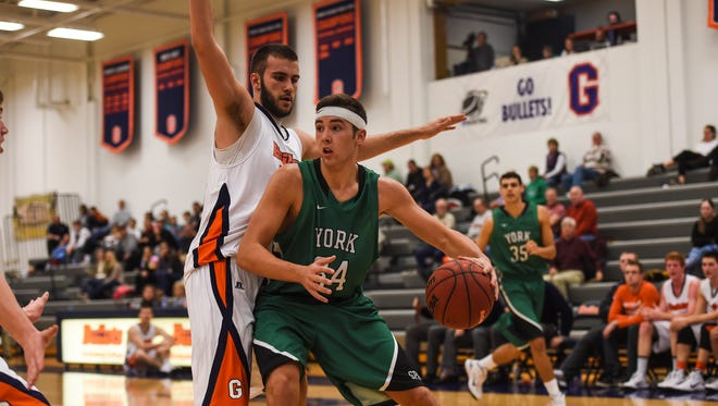 York College's Dalton Myers looks for an opening as Gettysburg's Vitor Melo defends on Wednesday Nov. 19, 2014 at Gettysburg College during men's basketball.
