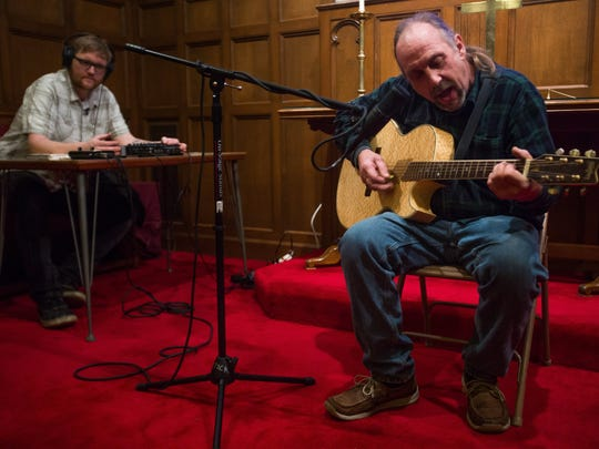 "Ypsilanti musician Matt Jones, left, records Kalamazoo musician Mike List, as he performs his song, ""How long are you going to keep me waiting"" on Sunday, Jan. 24, 2016."