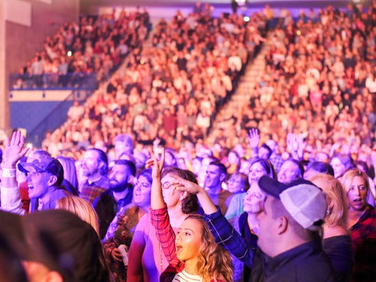 Fans enjoy a rare country concert at the Bob Carpenter Center last month. It featured performers Chris Young, Dustin Lynch and Cassadee Pope, along with surprise beer sales.