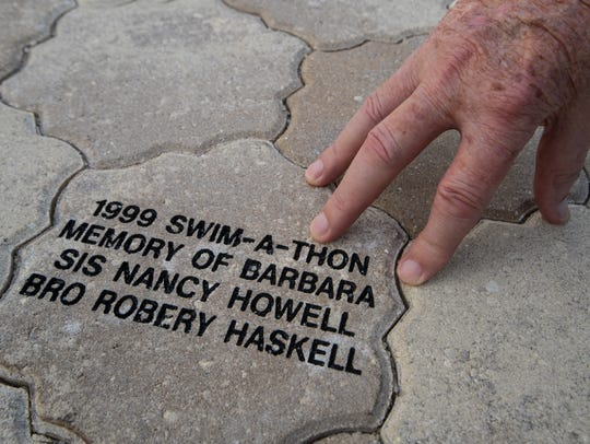 "Frank Haskell reflects on a memorial brick for his daughter Barbara Haskel at Golisano Children's Hospital Wednesday, November 8, 2017. Barbara was the inspiration for ""Barbara's Friends."""