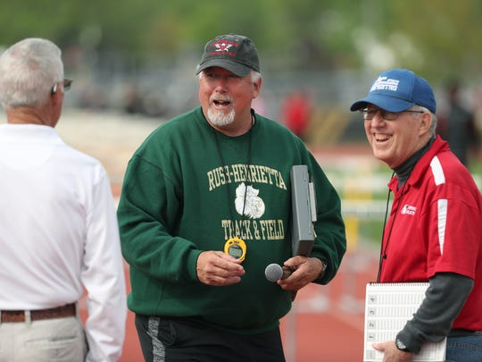 Rush-Henrietta track coach Mike DeMay (center)  shares