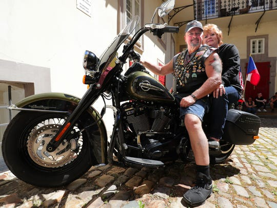 Gary Radmer and his wife, Wendy, of Slinger straddle the bike they rented in downtown Prague.