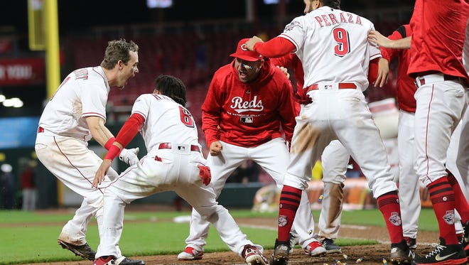 Cincinnati Reds second baseman Scooter Gennett (3) after hitting a two-run walk-off home run off Atlanta Braves relief pitcher Max Fried (54), not pictured, in the 12th inning to give the Reds a 9-7 win against the Atlanta Braves, Tuesday, April 24, 2018, at Great American Ball Park in Cincinnati.