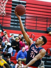 Oakland's Tavon Jelks goes in for a layup during Tuesday's