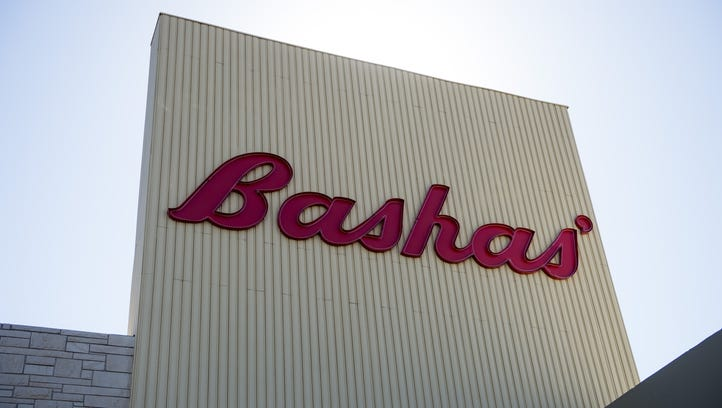 The exterior of a Bashas' at the corner of Seventh