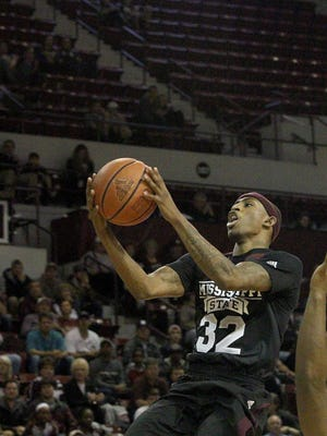 Mississippi State guard Craig Sword (32) leaps tp the basket past Alabama guard Retin Obasohan (32) during the first half of Tuesday's game.