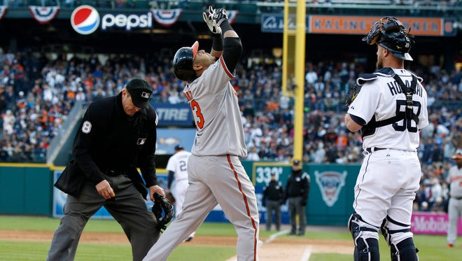 Baltimore's Nelson Cruz celebrates his 2 run home run  during sixth inning action in game three of the ALDS between Detroit Tigers and Baltimore Orioles in Detroit on Sunday, October 5, 2014.