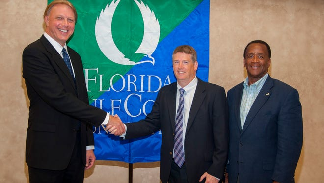 Left to right: Donald Schrotenboer, president of real estate at Private Equity Group; Christopher Simoneau, vice president of university advancement and executive director of the FGCU Foundation; and FGCU President Wilson Bradshaw.