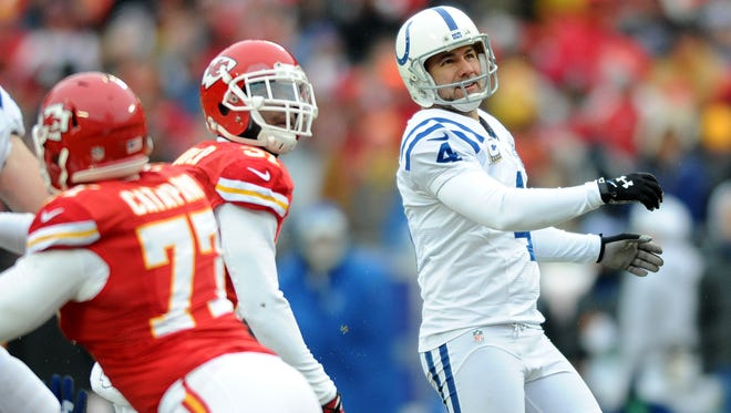 Indianapolis Colts kicker Adam Vinatieri watches his kick sail through the uprights against the Kansas City Chiefs during the second half, Sunday, December 22, 2013, at Arrowhead Stadium.