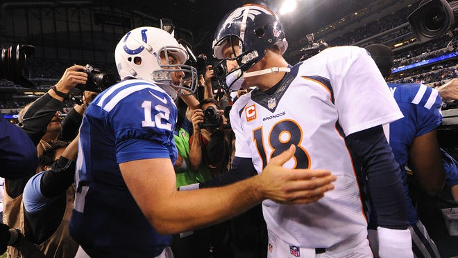 Indianapolis Colts' Andrew Luck (12) and Denver Broncos' Peyton Manning (18) meet on the field after the Bronco's 39-33 loss to Indianapolis.