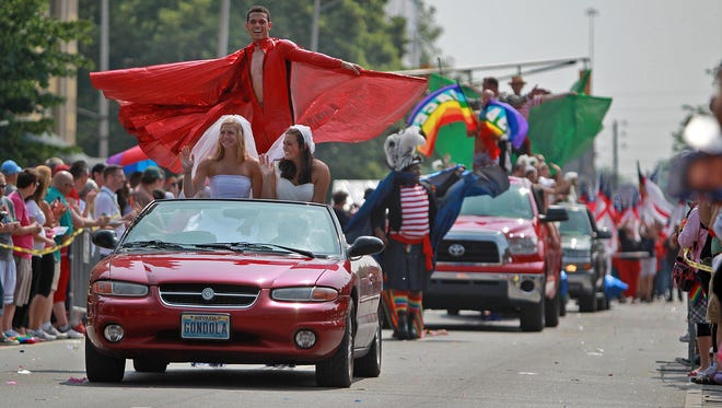 The Cadillac Barbie Pride Parade moves along its route during last year's event.