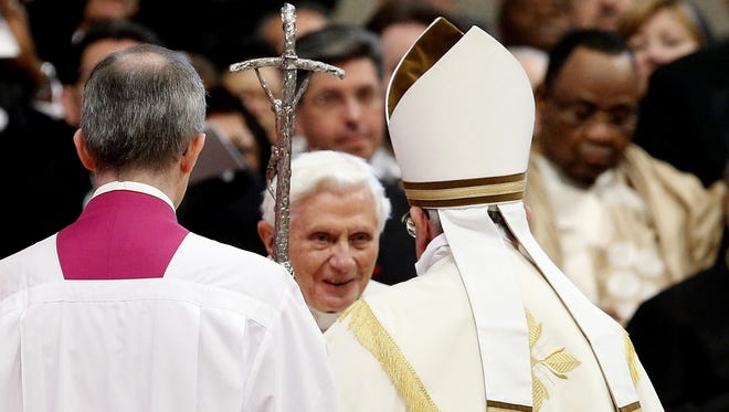 Pope Emeritus Benedict XVI  is greeted by Pope Francis as he arrives inside St. Peter's Basilica on Feb. 22, 2014.