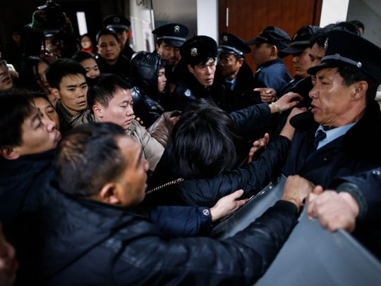 Angry family members clash with security personnel