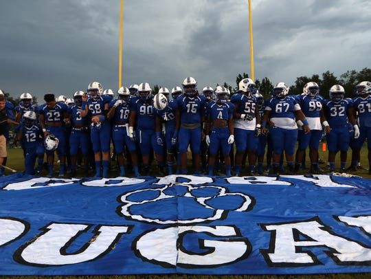 Godby players prepare to charge out on to the field