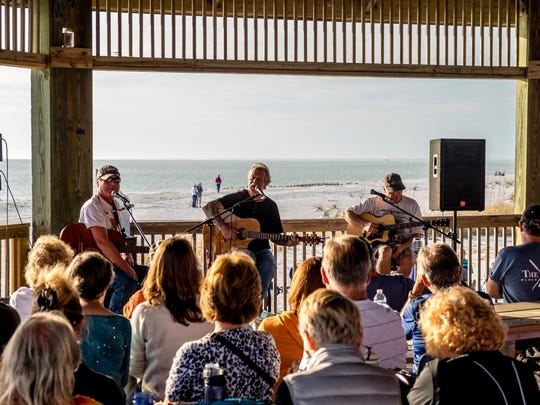 The beach gazebo at Lovers Key provides the perfect stage for the monthly Songwriters at Sunset acoustic concert series.