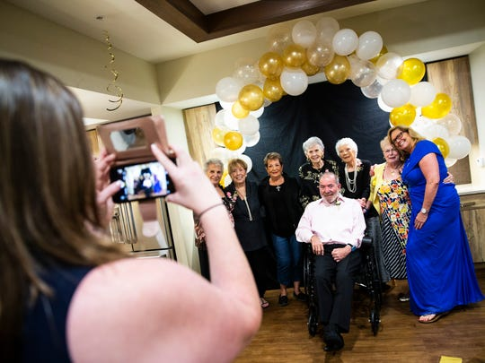 "Patti Kuehl, the Life Enrichment Director, right, poses for a photo with a group of attendees during the ""senior"" prom at American House Coconut Point in Estero on Wednesday, May 30, 2018."