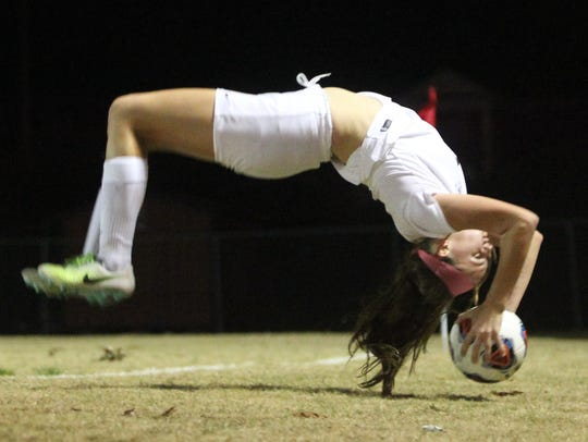Leon's Madison Rumenik flip throws a ball on a set