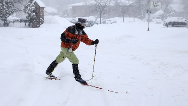 Jen Perena took advantage of the heavy snowfall to use her cross country skis along Park Avenue.